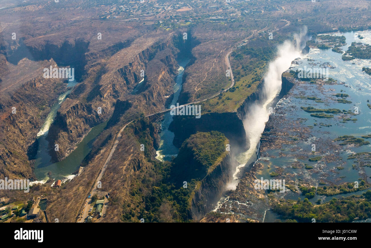 The Victoria falls is the largest curtain of water in the world. The falls and the surrounding area is the Mosi - Stock Image