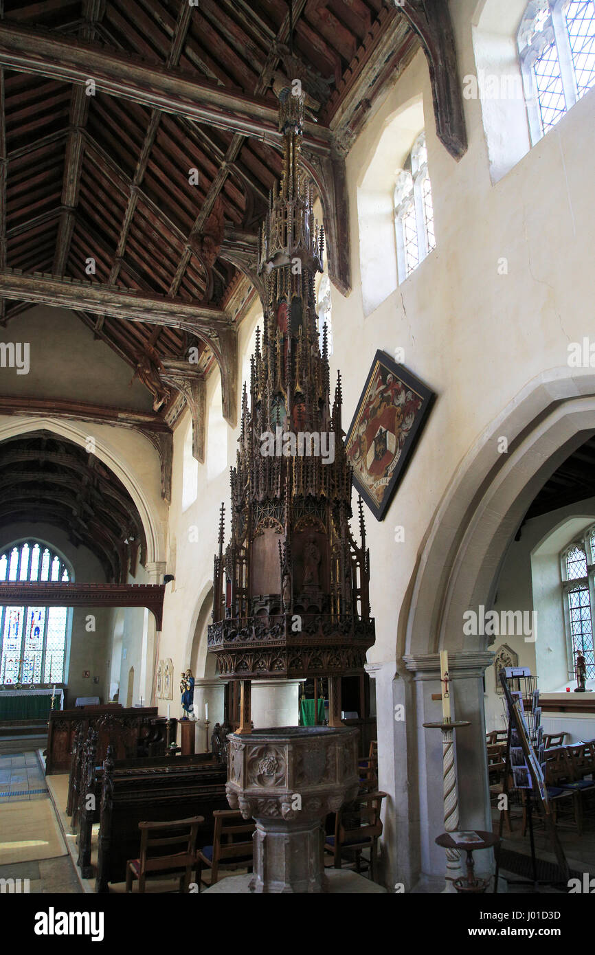 Ornately decorated large wooden baptismal font cover Ufford church, Suffolk, England, UK - Stock Image