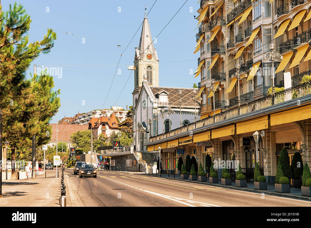 Montreux, Switzerland - August 27, 2016: Church and Luxury hotel on Geneva Lake Riviera in Montreux, Vaud canton, - Stock Image