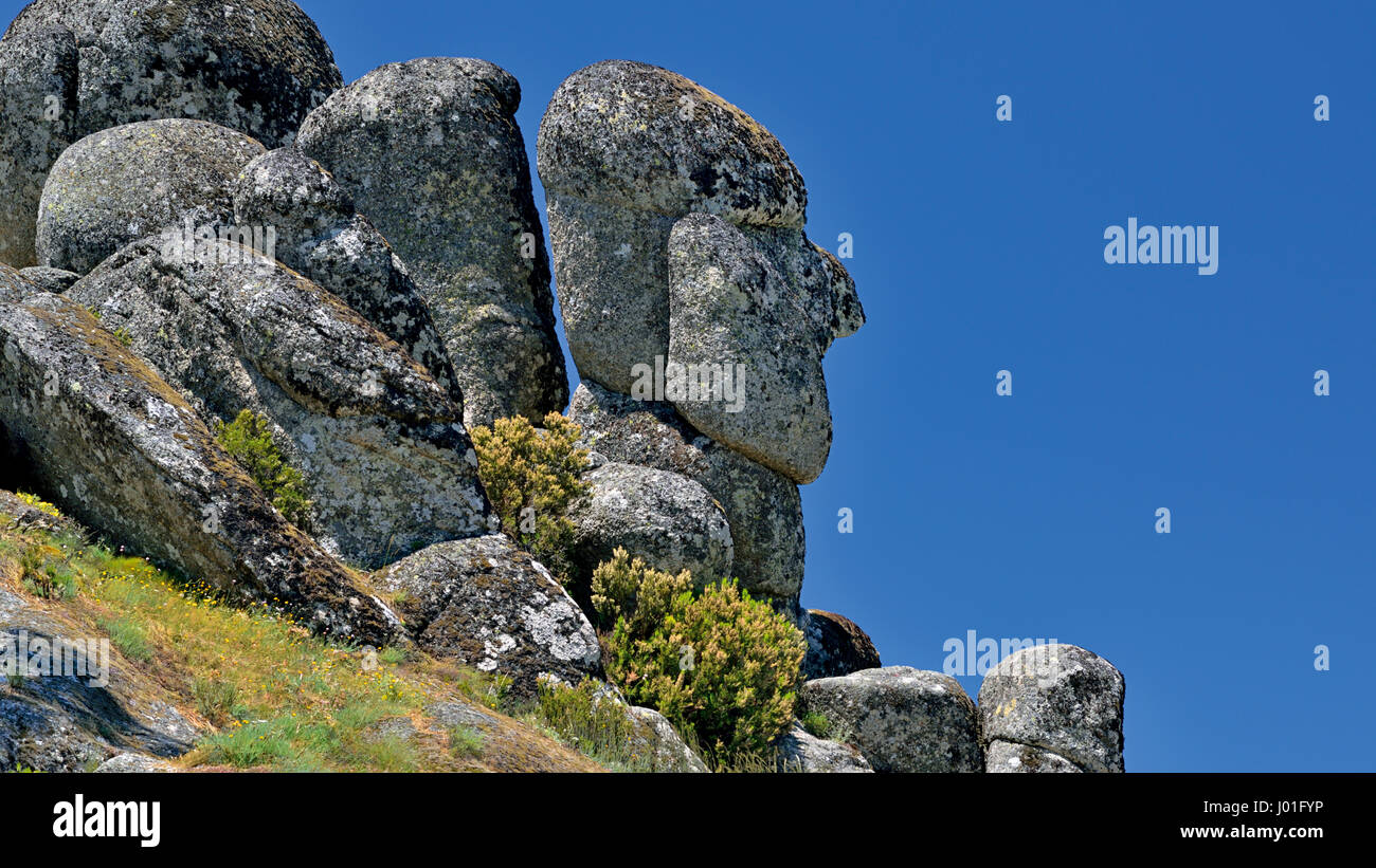 Natural formed silhouette of an old man in a huge granite rock - Stock Image