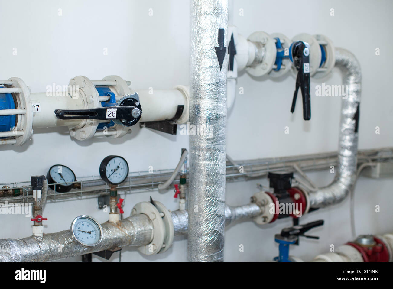 Pipes in a boiler room. Isolation of pipes. Water heating. Power ...