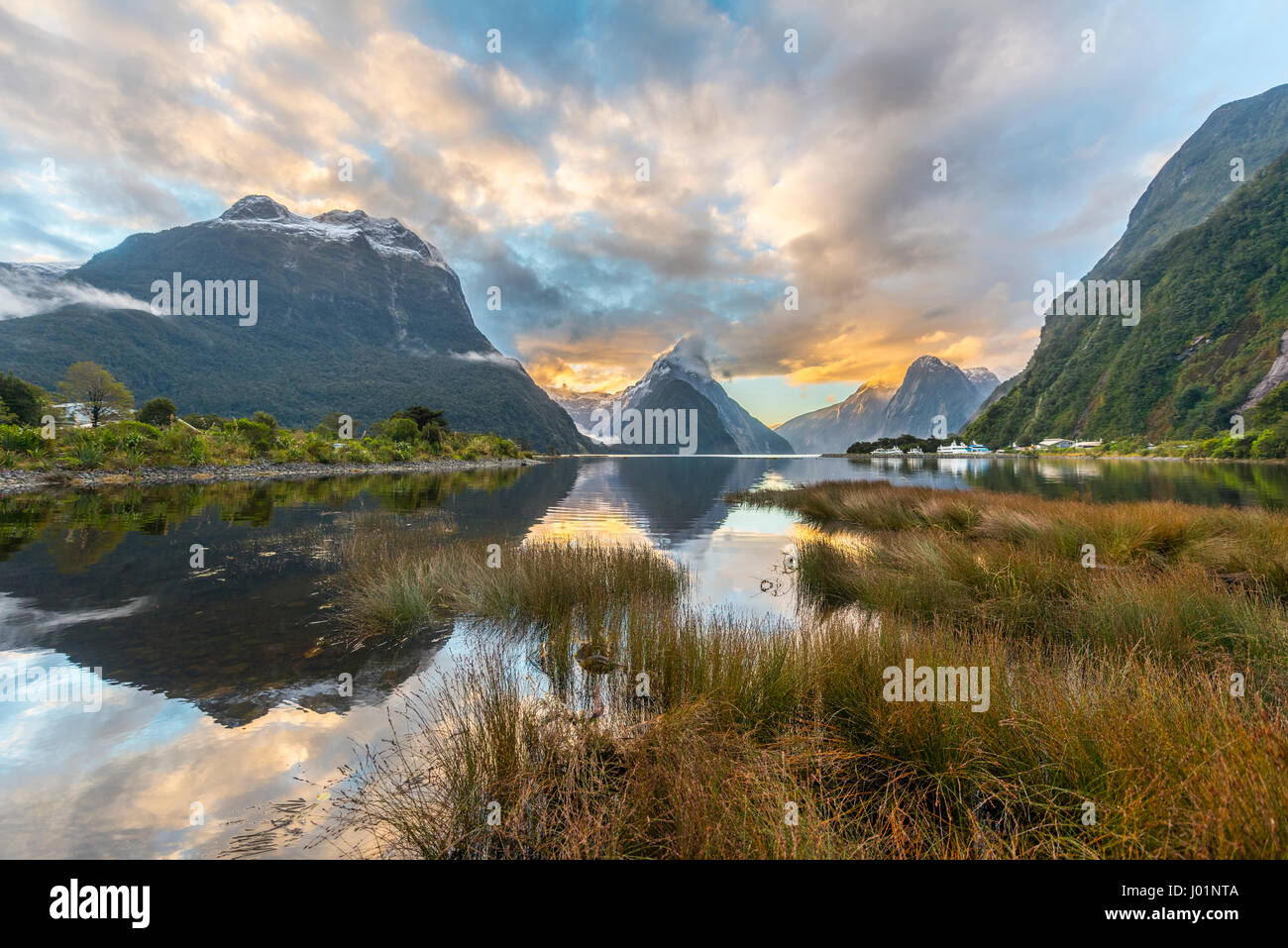 Mitre Peak reflecting in the water, sunset, Milford Sound, Fiordland National Park, Te Anau, Southland Region, Southland Stock Photo