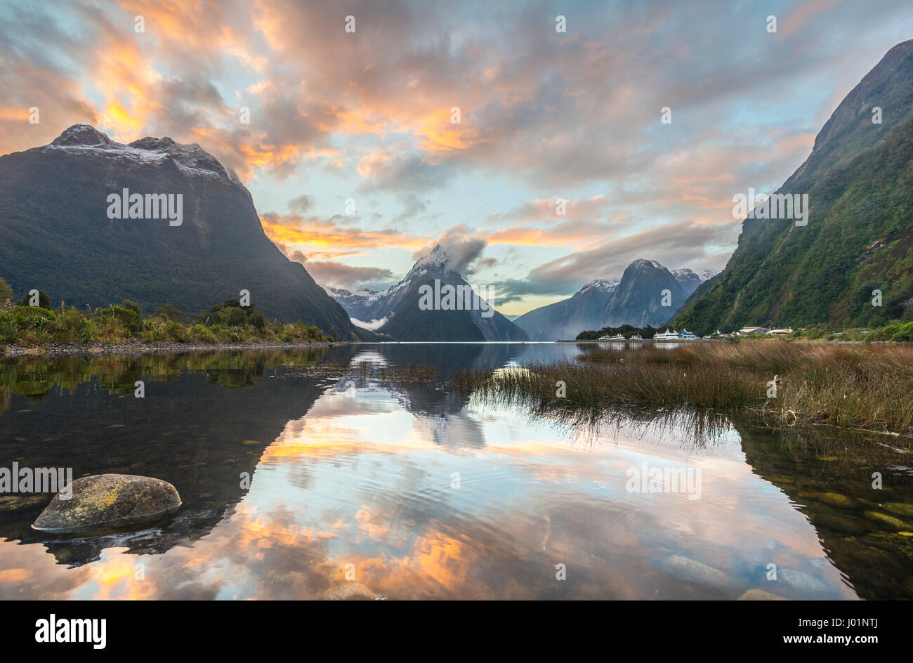 Mitre Peak reflecting in the water, sunset, Milford Sound, Fiordland National Park, Te Anau, Southland Region, Southland - Stock Image