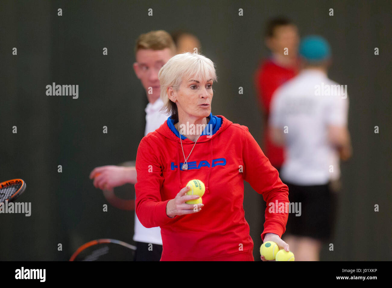 Judy Murray coaching tennis to a mixture of adults and children - Stock Image