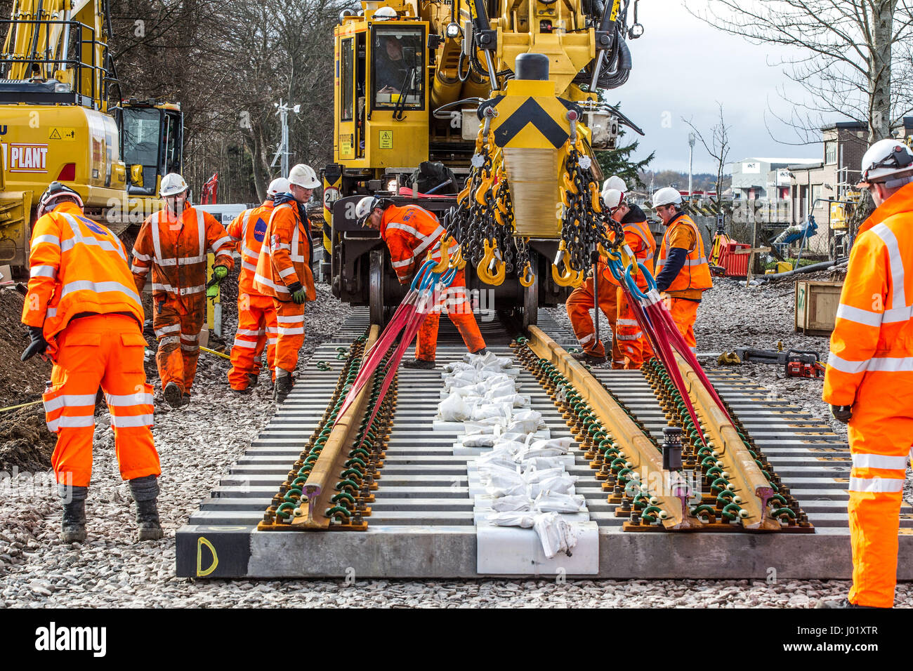 Rail construction workers installing new tracks and points - Stock Image