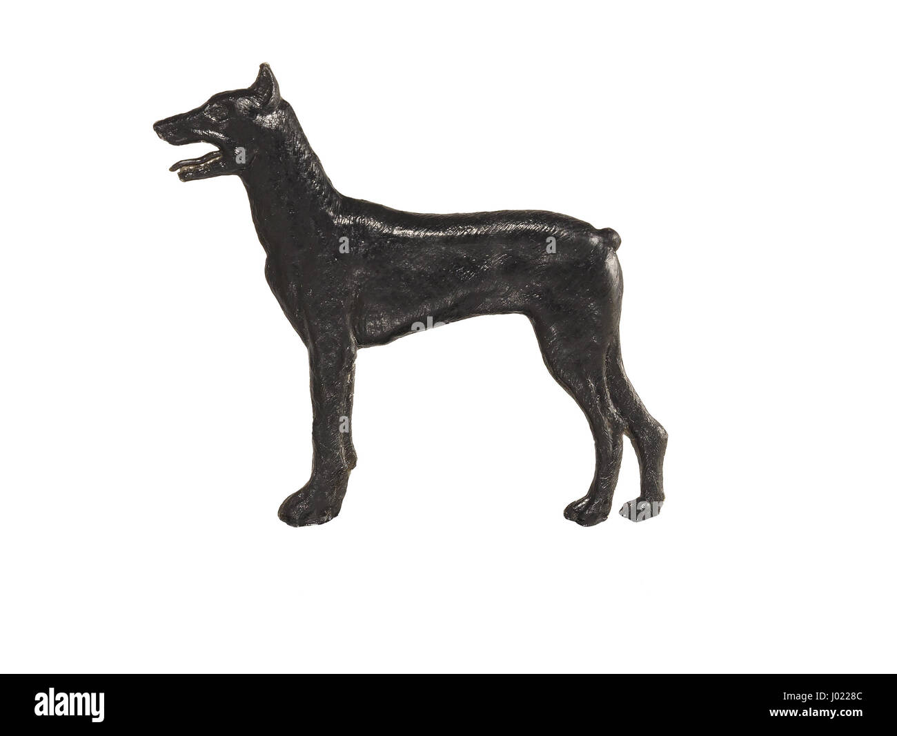 Black dog figure on white background, Doberman Pinscher - Stock Image