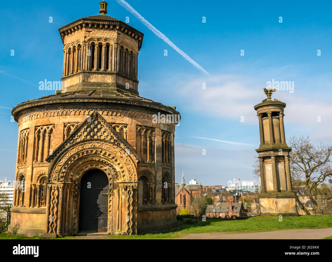 Elaborately carved round Victorian mausoleum, Necropolis hilltop overlooking Glasgow, Scotland, UK, with blue sky - Stock Image