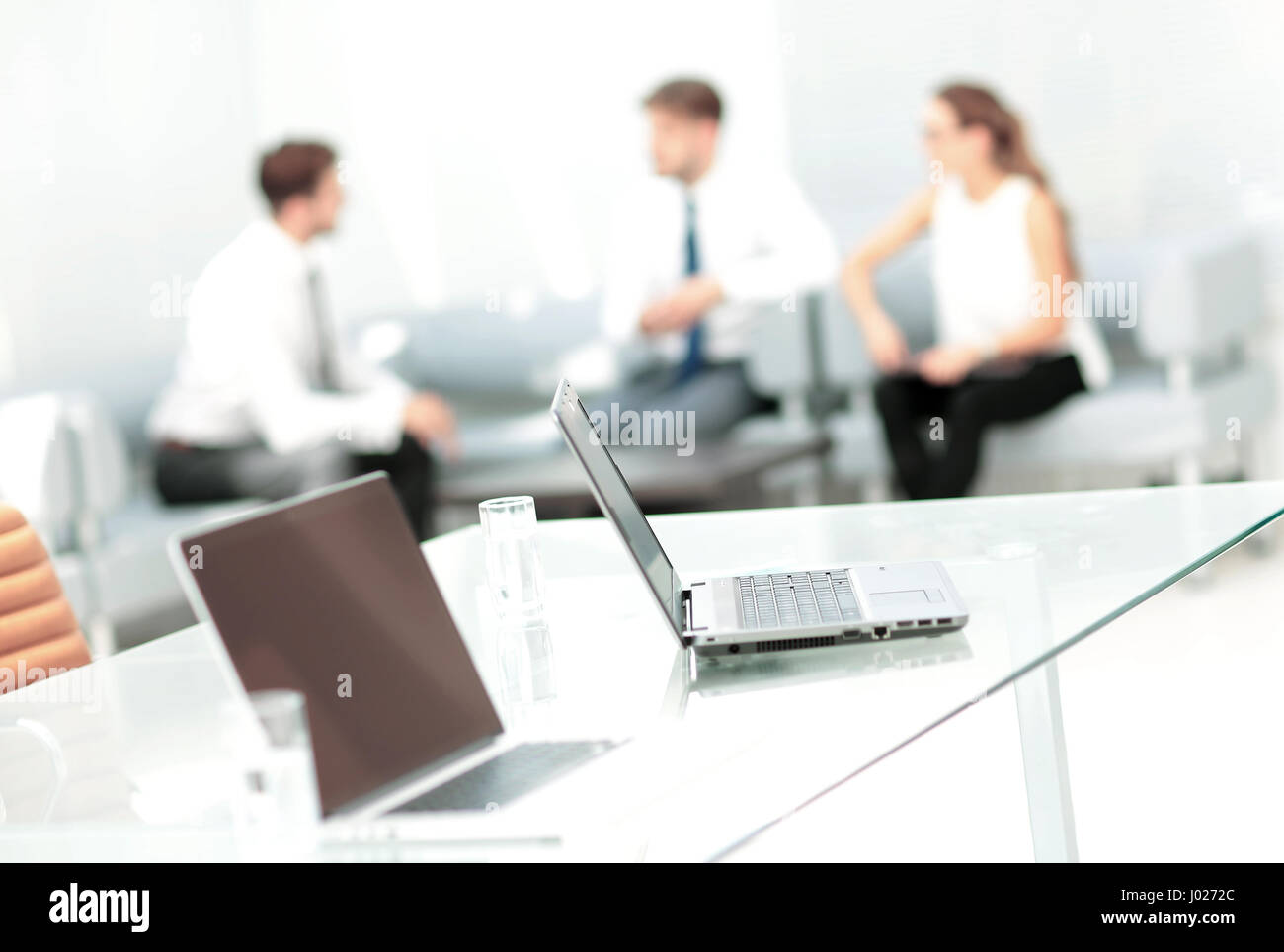 Close up image of a business people working in a modern office - Stock Image