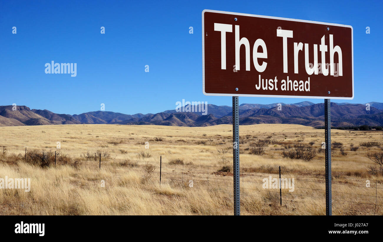 The Truth road sign with blue sky and wilderness - Stock Image
