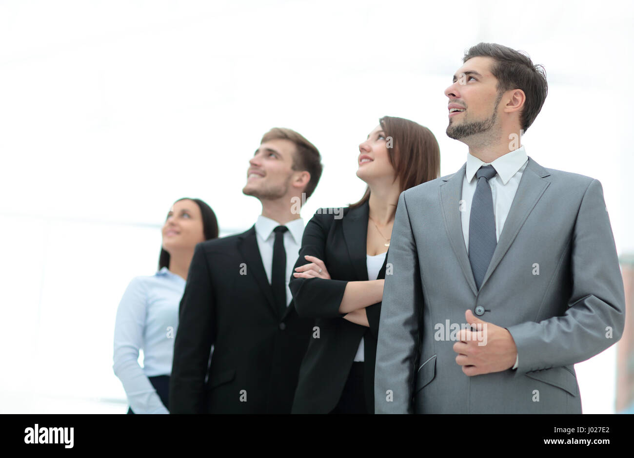 Group of happy and successful business people looking up - Stock Image