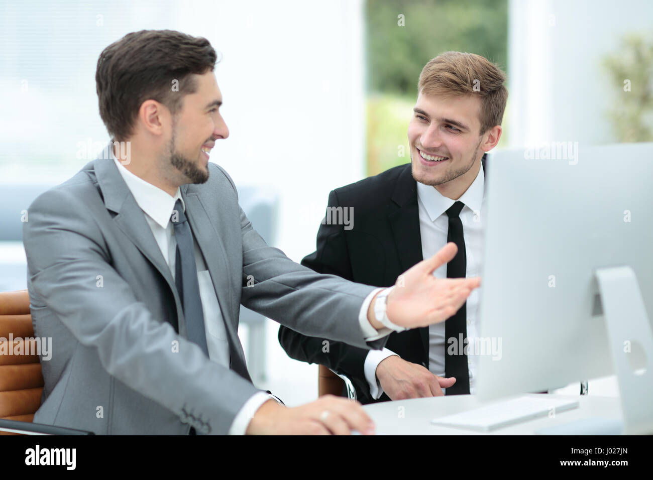 Business people at work. Two business people in formalwear discu - Stock Image