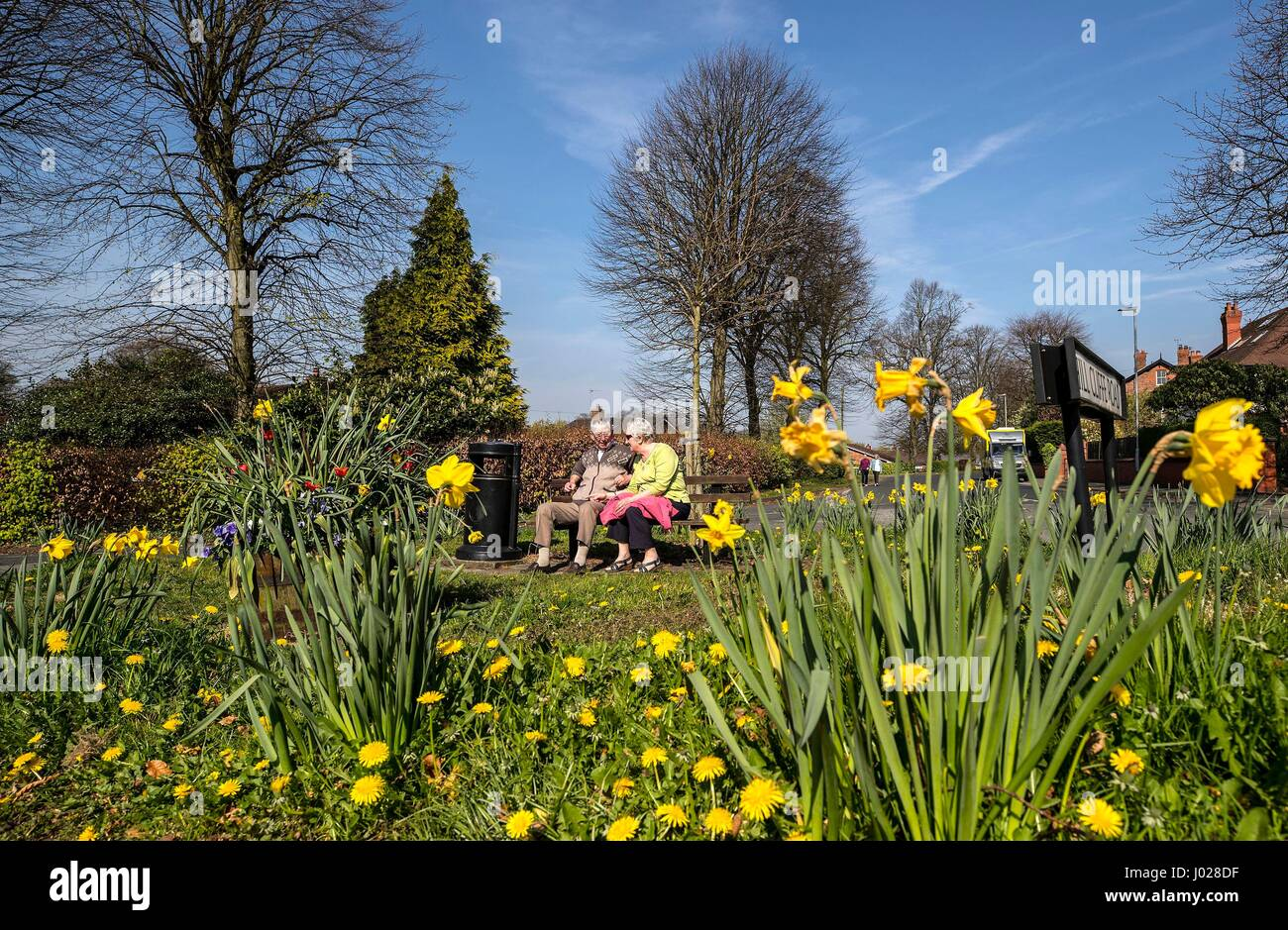 A couple sit on a bench in Stockton Heath in Cheshire, on what is expected to be the hottest day of the year so - Stock Image