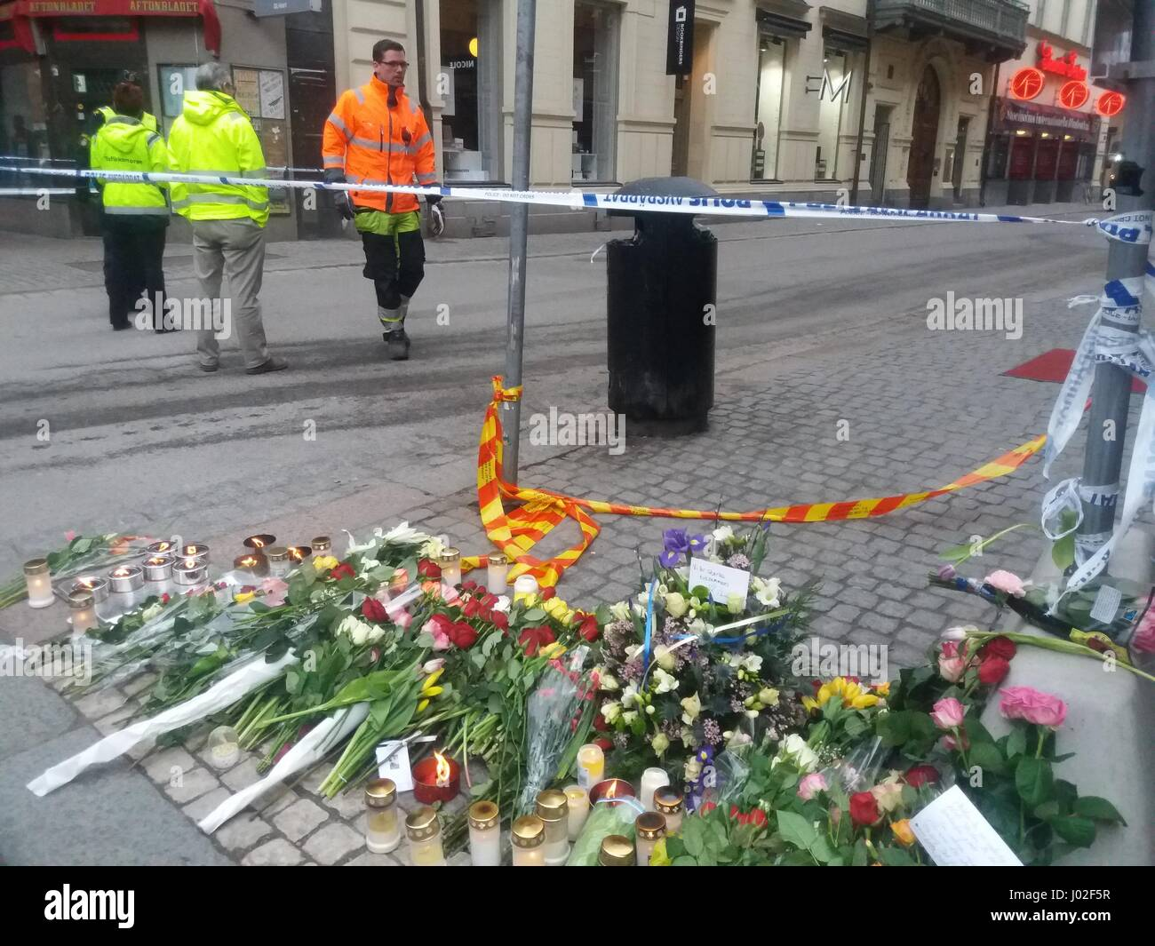 Swedish Polis officers guarding part of a crash scene, in central Stockholm where the high-speed truck terrorist - Stock Image