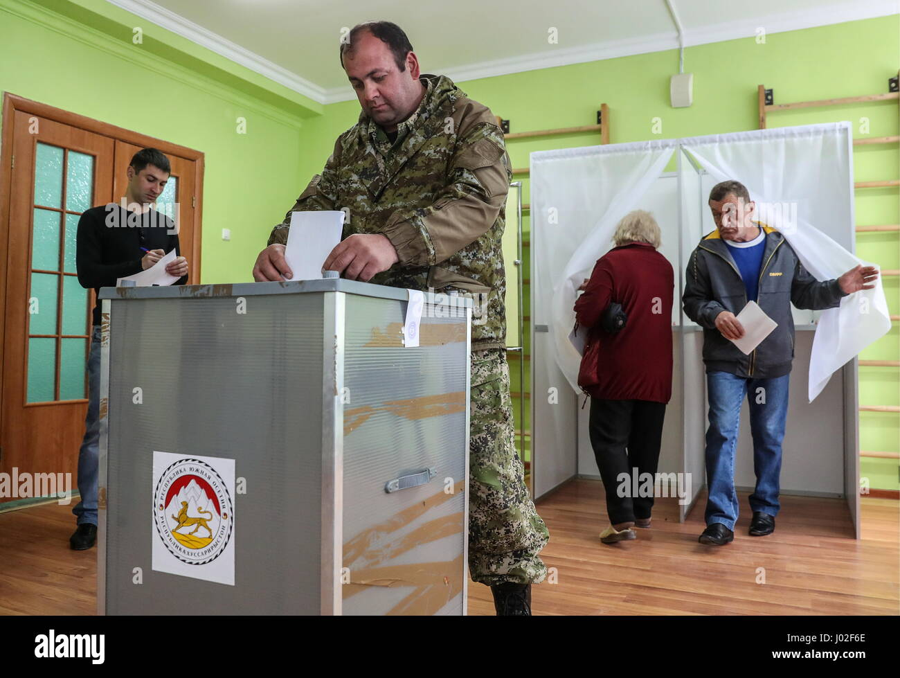 Tskhinval, South Ossetia. 9th Apr, 2017. Citizens vote at the 2017 South Ossetian presidential election at a polling - Stock Image