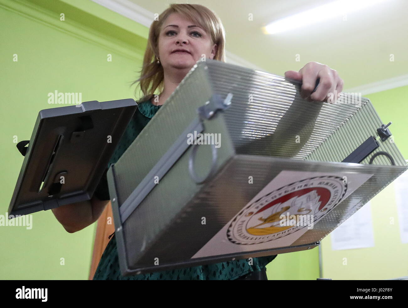 Tskhinval, South Ossetia. 9th Apr, 2017. An Election Commission member shows an empty ballot box ahead of the 2017 - Stock Image