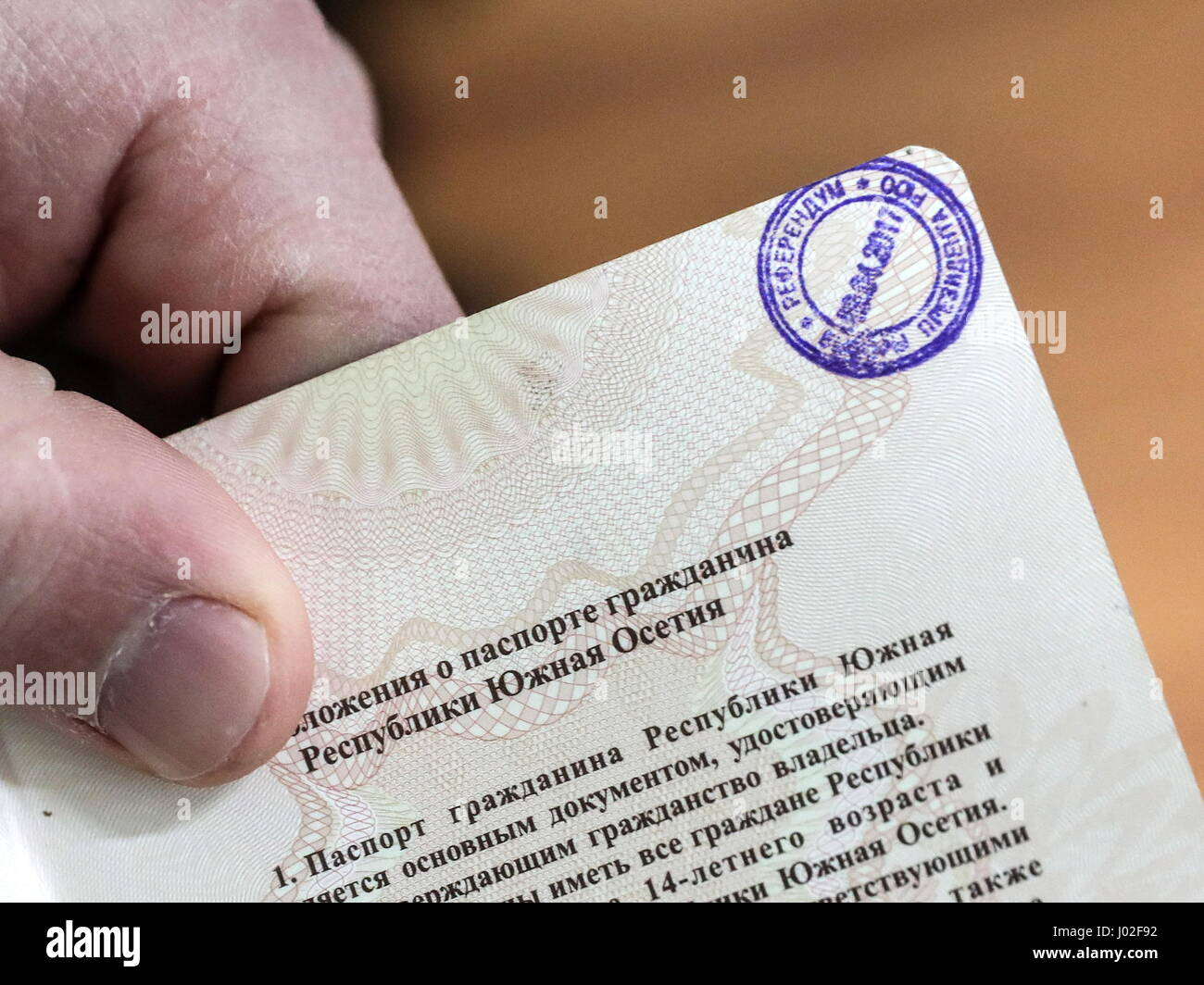 Tskhinval, South Ossetia. 9th Apr, 2017. An election mark on a South Ossetian passport during the 2017 South Ossetian - Stock Image