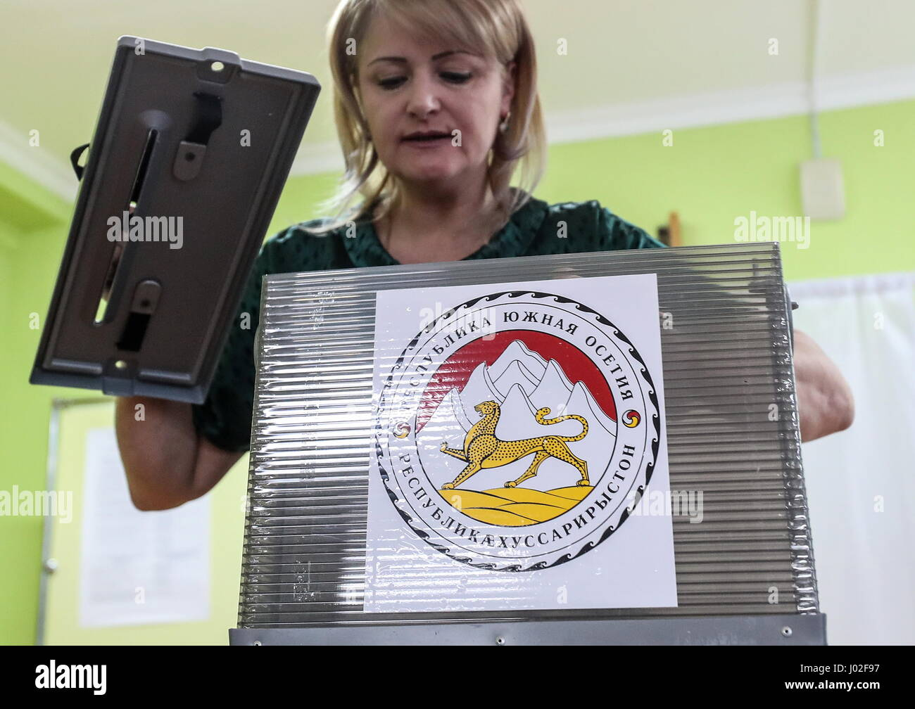 Tskhinval, South Ossetia. 9th Apr, 2017. An Election Commission member checks a ballot box ahead of the 2017 South - Stock Image