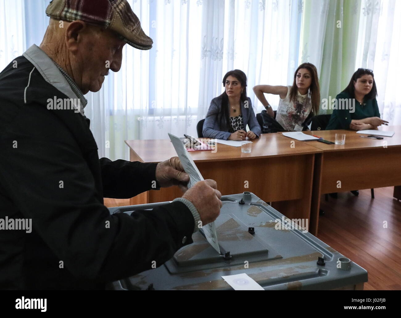 Tskhinval, South Ossetia. 9th Apr, 2017. A citizen votes at the 2017 South Ossetian presidential election at a polling - Stock Image
