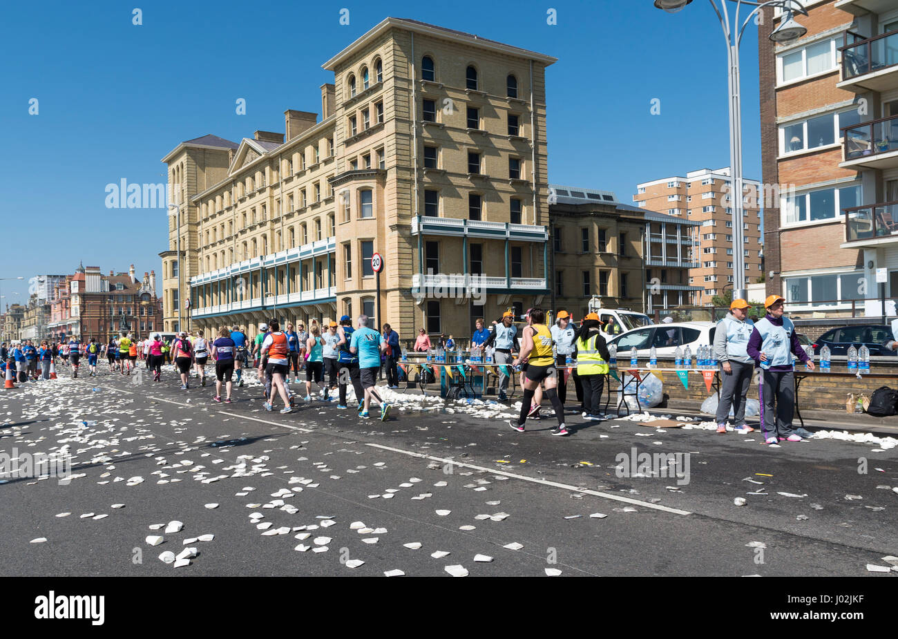 Brighton, UK. 9th Apr, 2017. Water stations ran out of cups, forcing runners to drink out of open bottles of water. - Stock Image