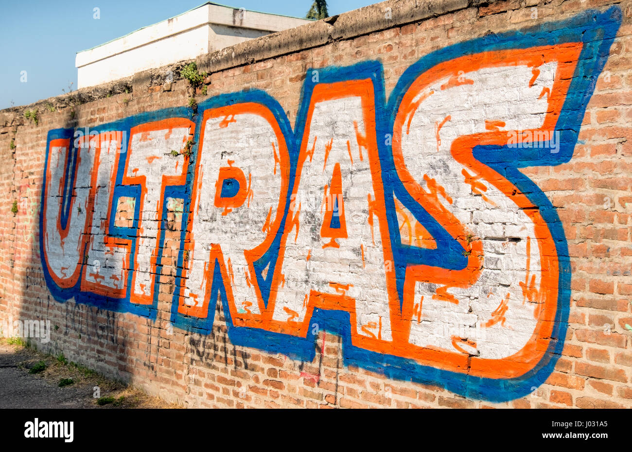 Bologna, Italy, 08 Apr 2017: Ultras football fan graffiti written on a brick wall near the stadium area - Stock Image