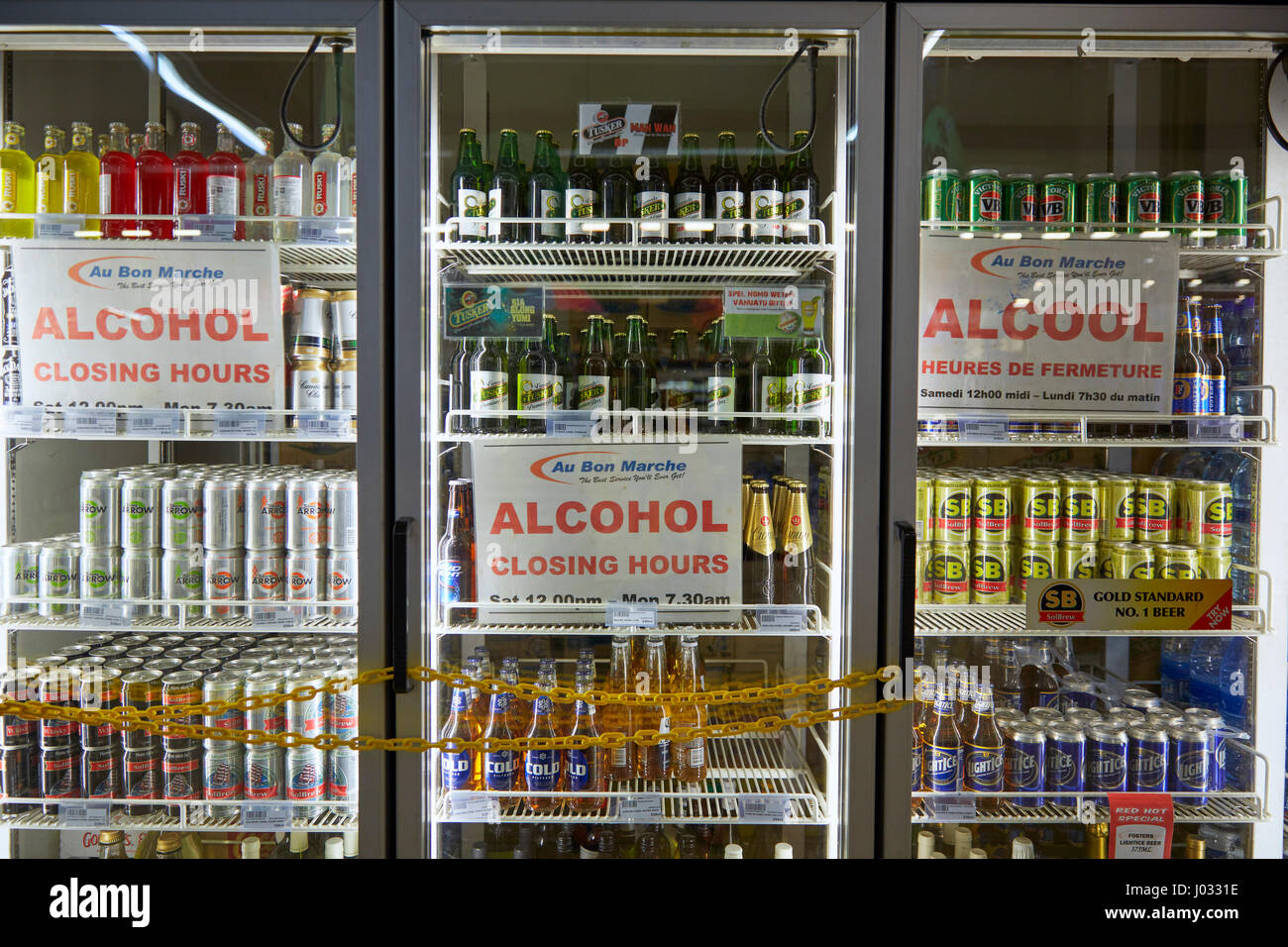 Alcohol Closing Hours sign in Au Bon Marche, Port Vila, Efate Island, Vanuatu - Stock Image