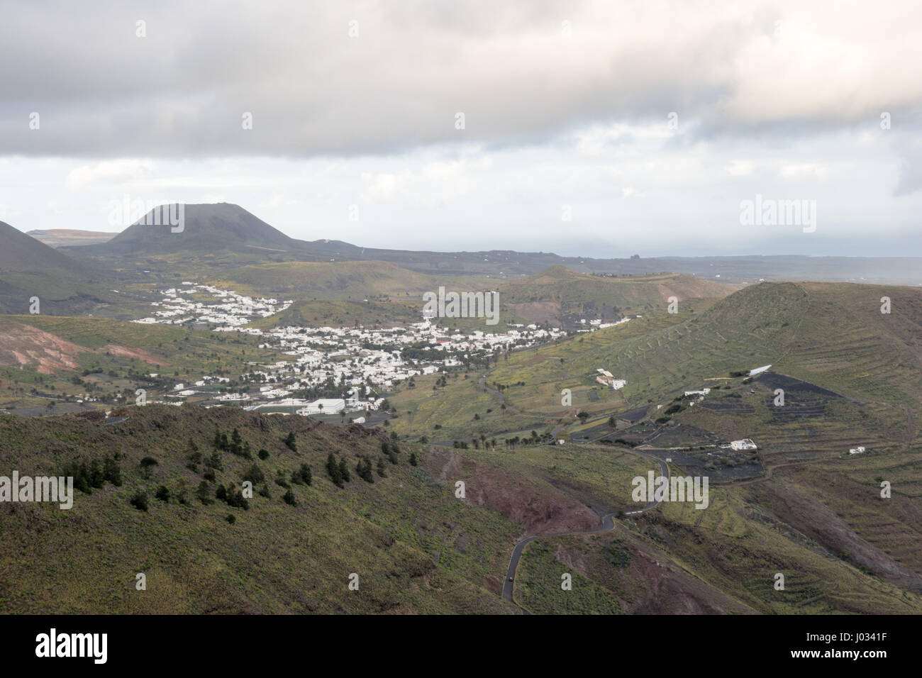 View of Haria from Mirador de Haría in Lanzarote on a cloudy  winter day. This town is famous for being shaped - Stock Image