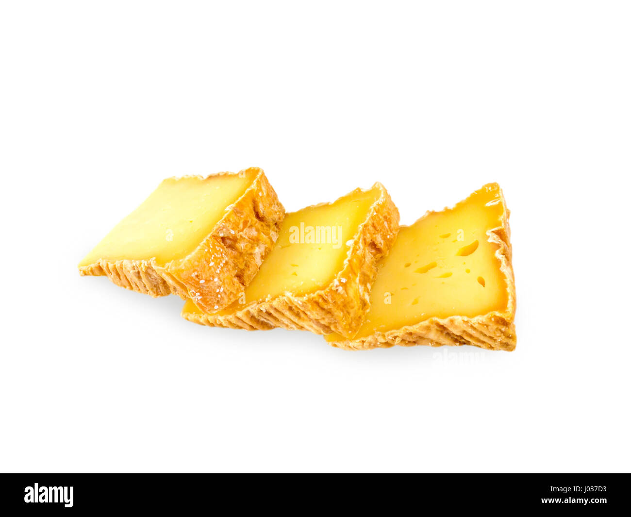 Three soft washed-rind cheese slices isolated on white - Stock Image