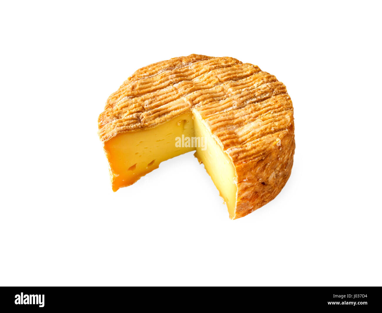 Soft washed-rind cheese round isolated on white - Stock Image