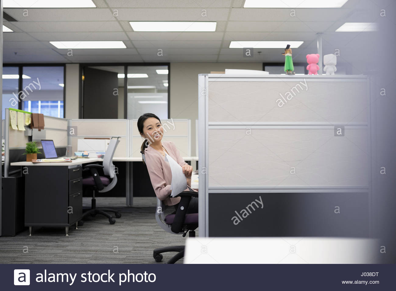 office cubical. Portrait Smiling Businesswoman With Paperwork At Office Cubicle Cubical H