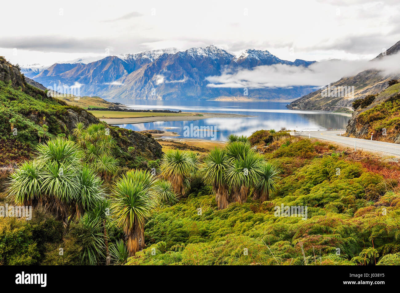 Clouds lying low over a lake near Wanaka in the Southern Lakes Region of New Zealand - Stock Image