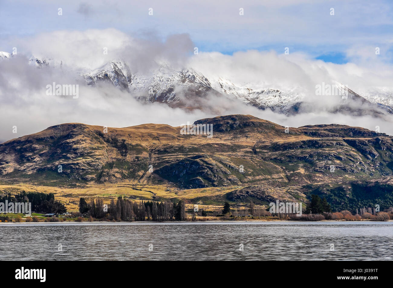 Snowy peaks near Wanaka in the Southern Lakes Region of New Zealand - Stock Image
