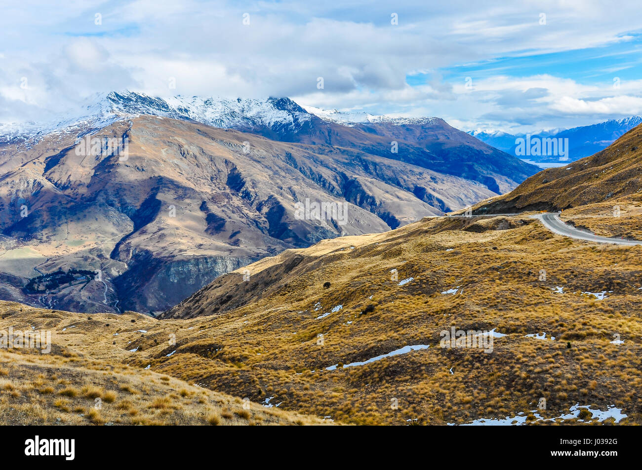 Crown Range Road near Queenstown in the Southern Lakes Region of New Zealand - Stock Image