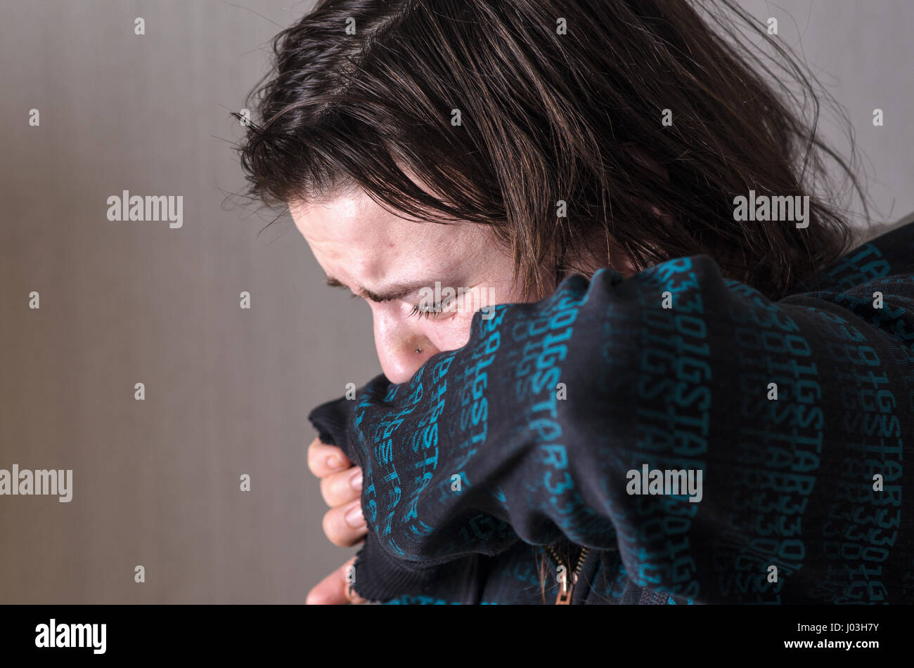 Girl crying in despair. Grief and real emotions. - Stock Image