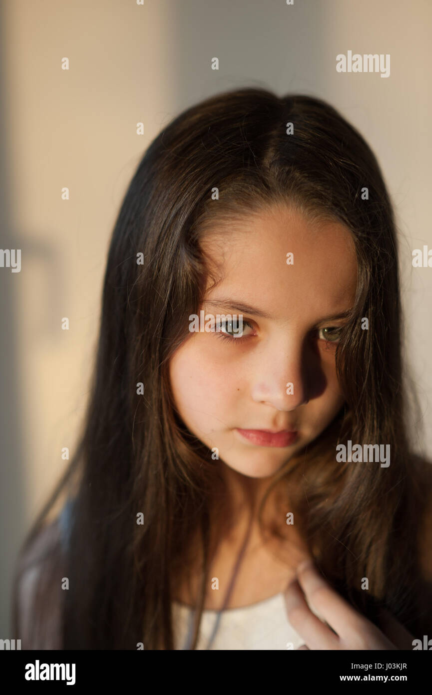 Beautiful young girl touching her hair with hand - Stock Image