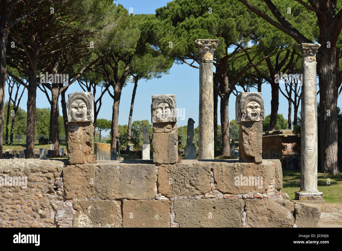 Rome. Italy. Ostia Antica. Marble theatrical masks at the rear of the theatre. - Stock Image