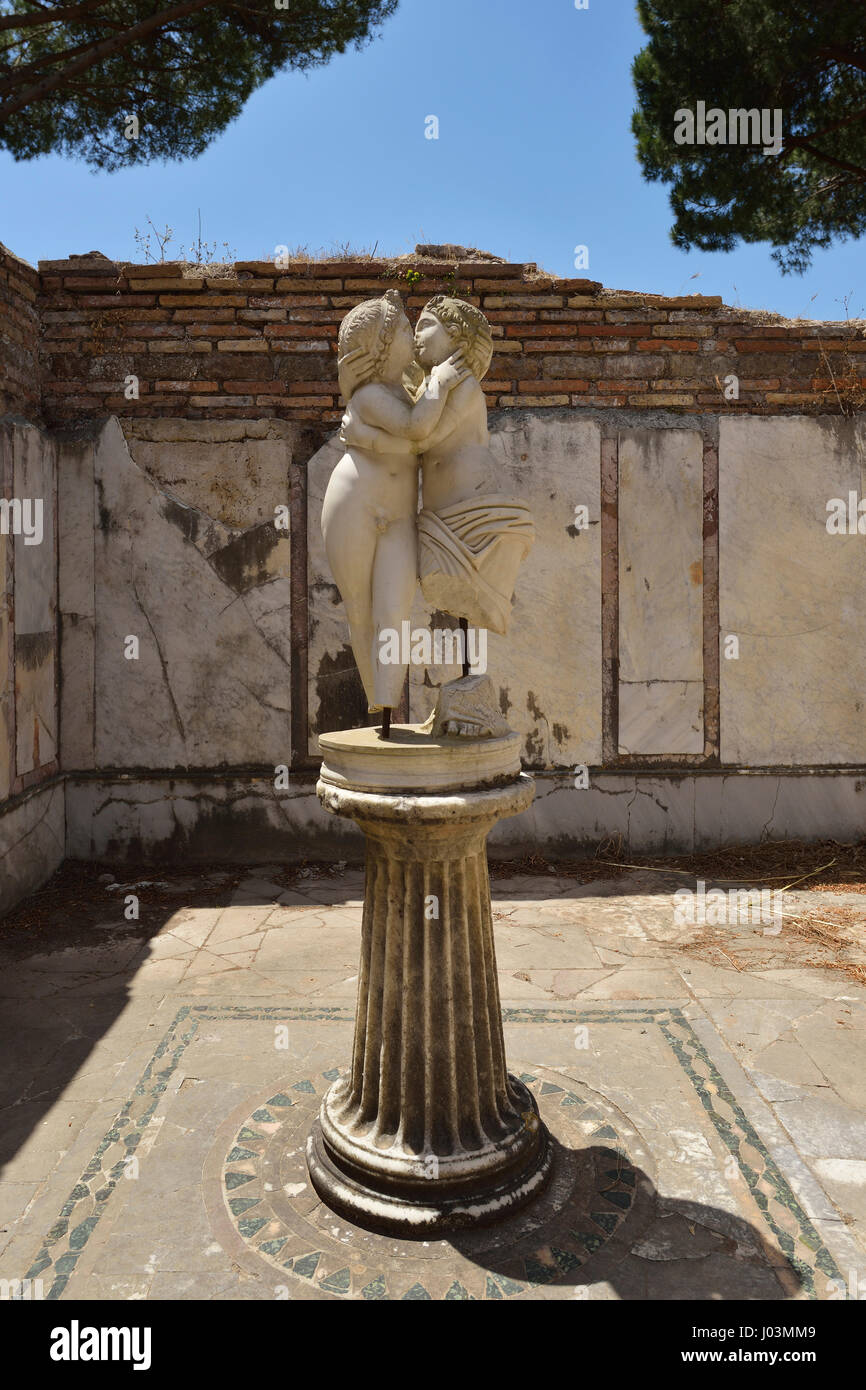 Rome. Italy. Ostia Antica. Statue of lovers embracing, House of Cupid and Psyche. Domus di Amore e Psiche. - Stock Image