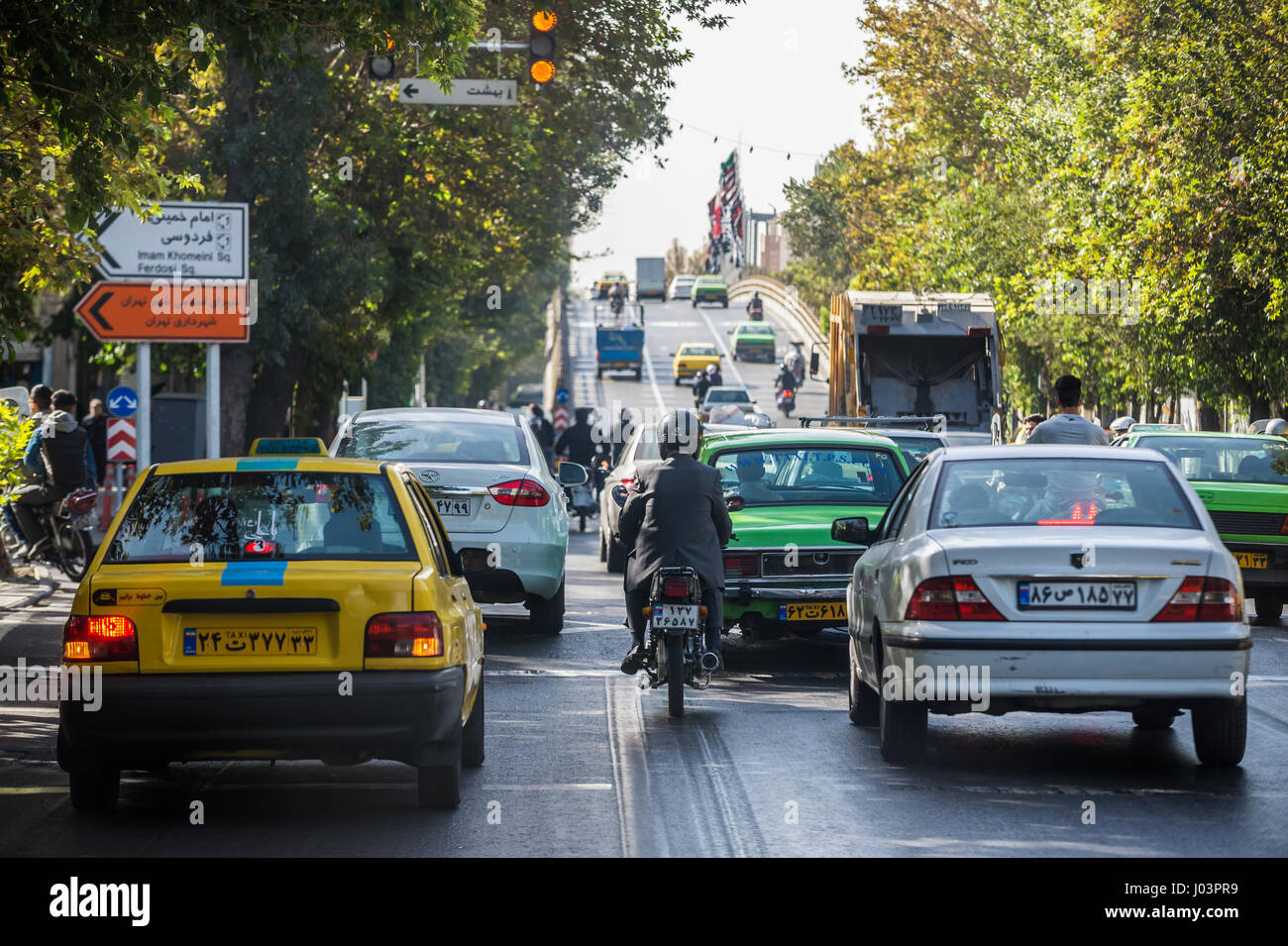 Traffic on a street in Tehran city, capital of Iran and Tehran Province - Stock Image