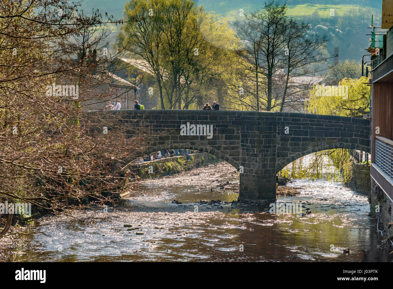 The ancient packhorse bridge over the river Calder in the centre of Hebden Bridge. Calderdale West Yorkshire. - Stock Image