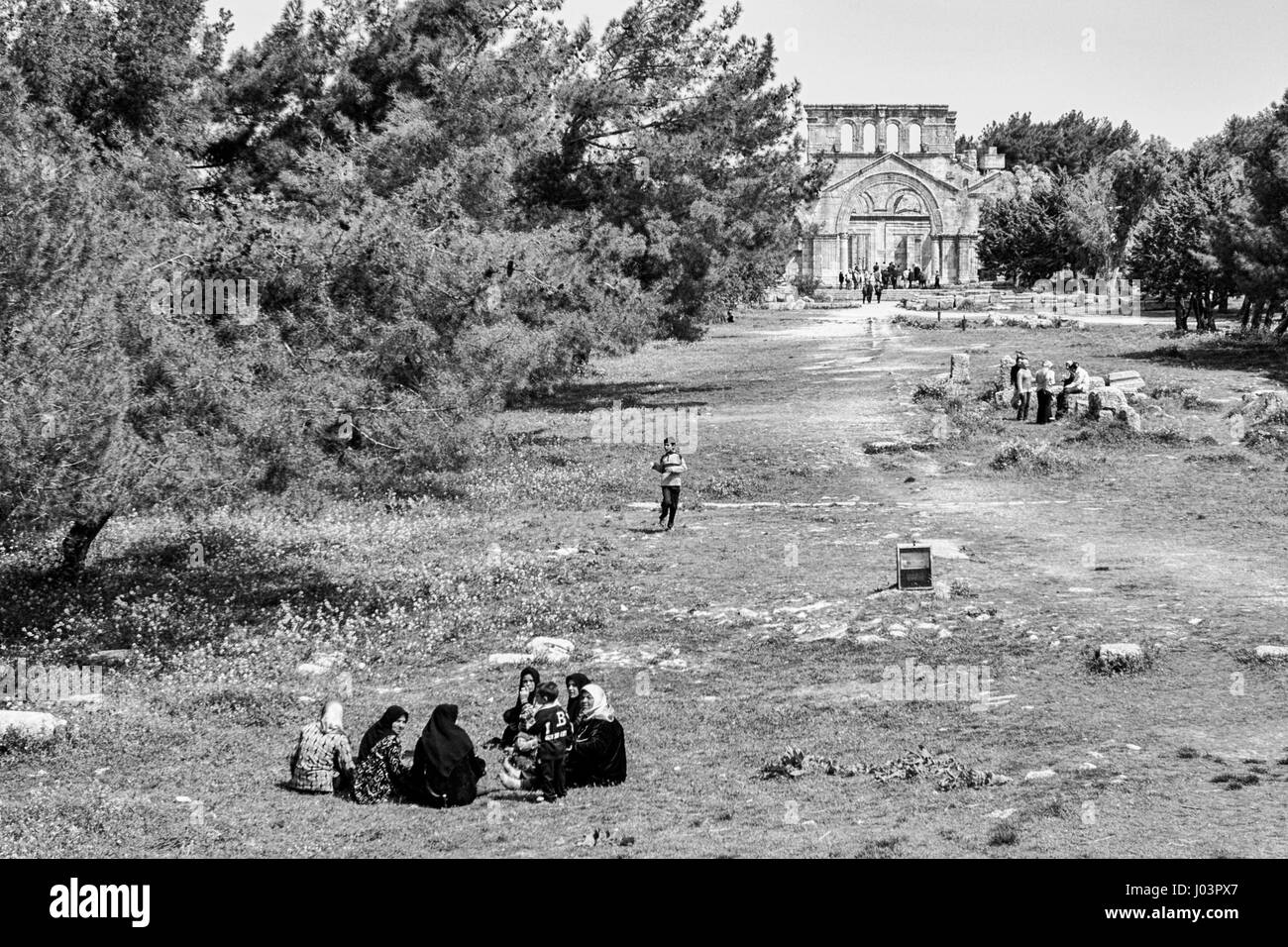 Families having picnics at the ruins of Basilica of St. Simeon. - Stock Image