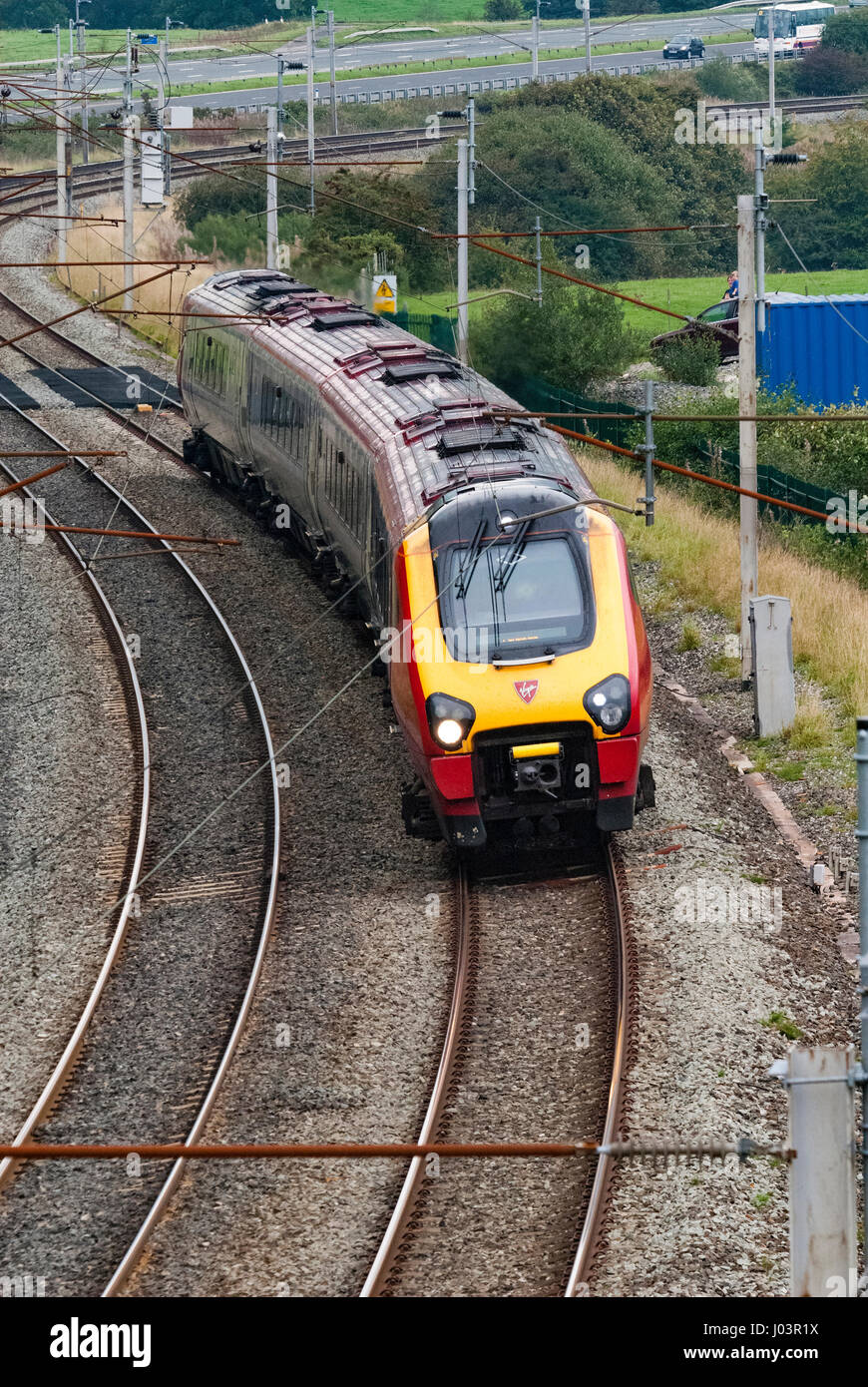 Virgin passenger train on the West Coast Main Line in Cumbria. Voyager. Stock Photo