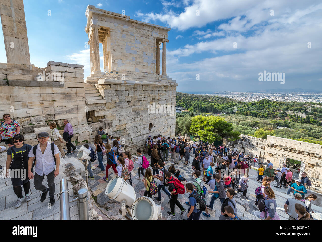 Tourists on a stairs in front of gateway called Propylaea, entrance to the top of Acropolis of Athens city, Greece. Stock Photo