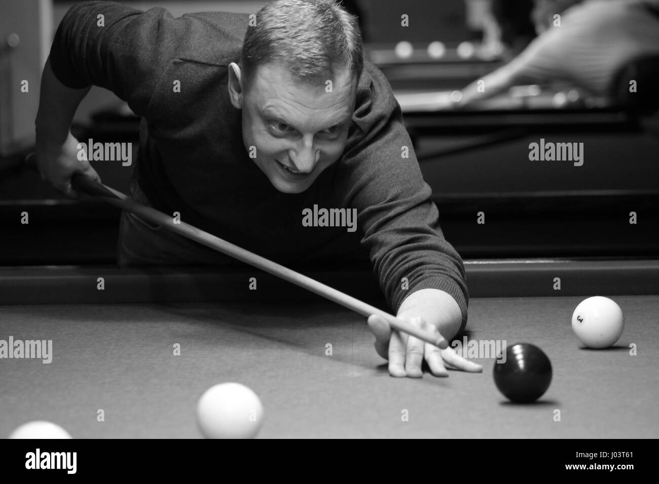 boy aiming for shot the billiard ball - Stock Image