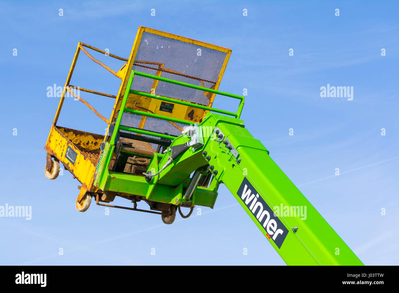 Empty stationary lifting arm of a Winner Access cherry picker construction vehicle. - Stock Image