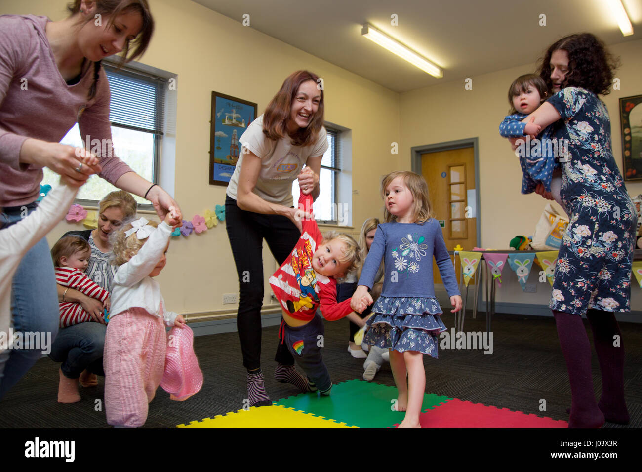 Playing games at a local playgroup - Stock Image