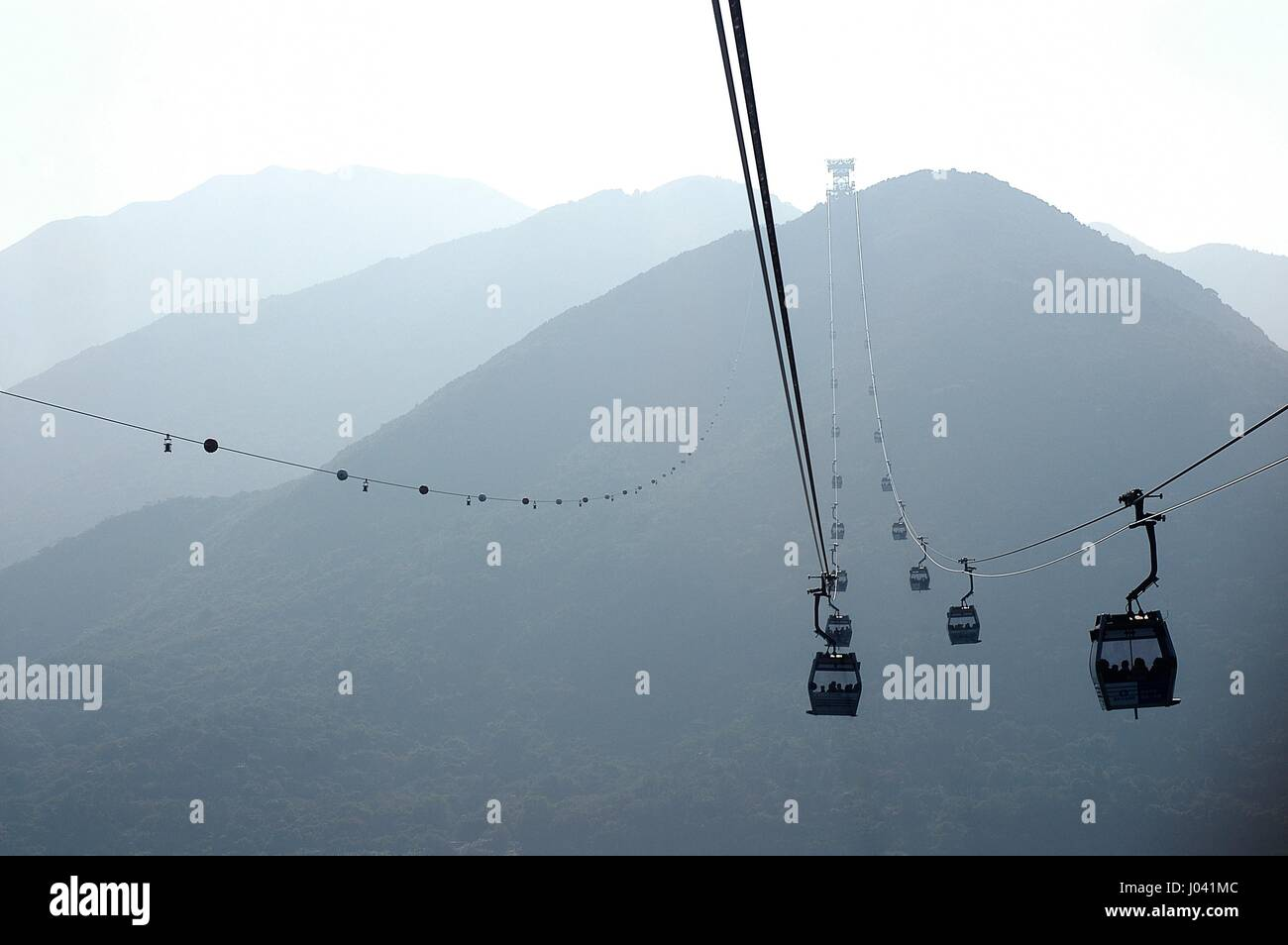 A sweeping view of mountains aboard Ngong Ping 360, Lantau Island. - Stock Image