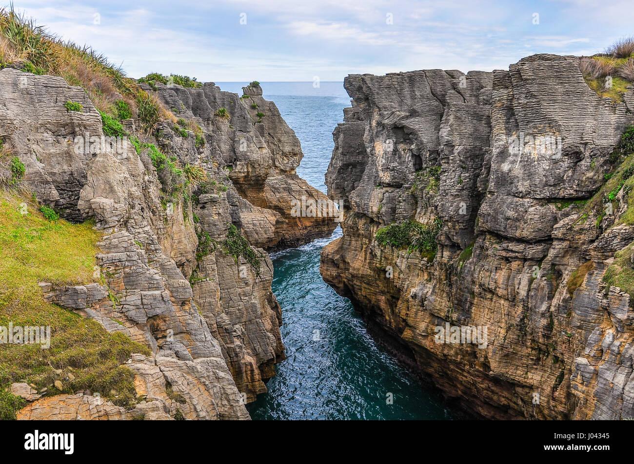 Pancake rocks in Punakaiki on the West Coast of New Zealand - Stock Image