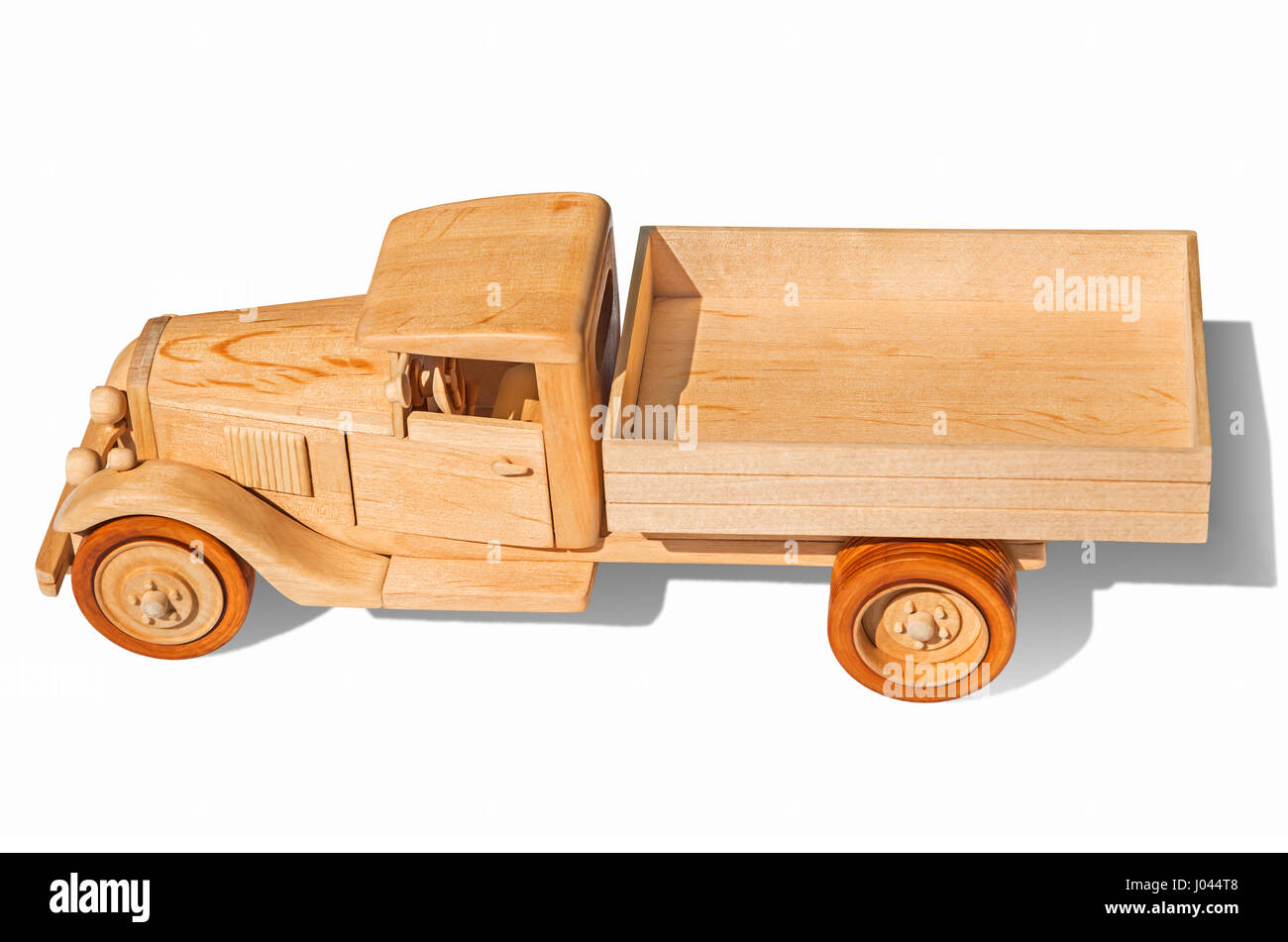 Wooden model of retro freight car on a white background - Stock Image