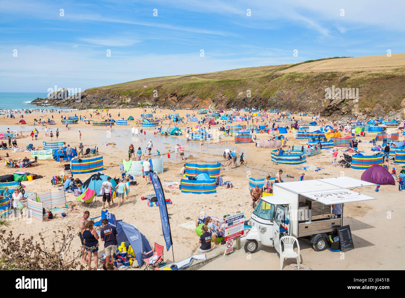 Trevone bay cornwall Trevone bay Seaside village and busy beach packed with holidaymakers cornwall Cornwall west - Stock Image