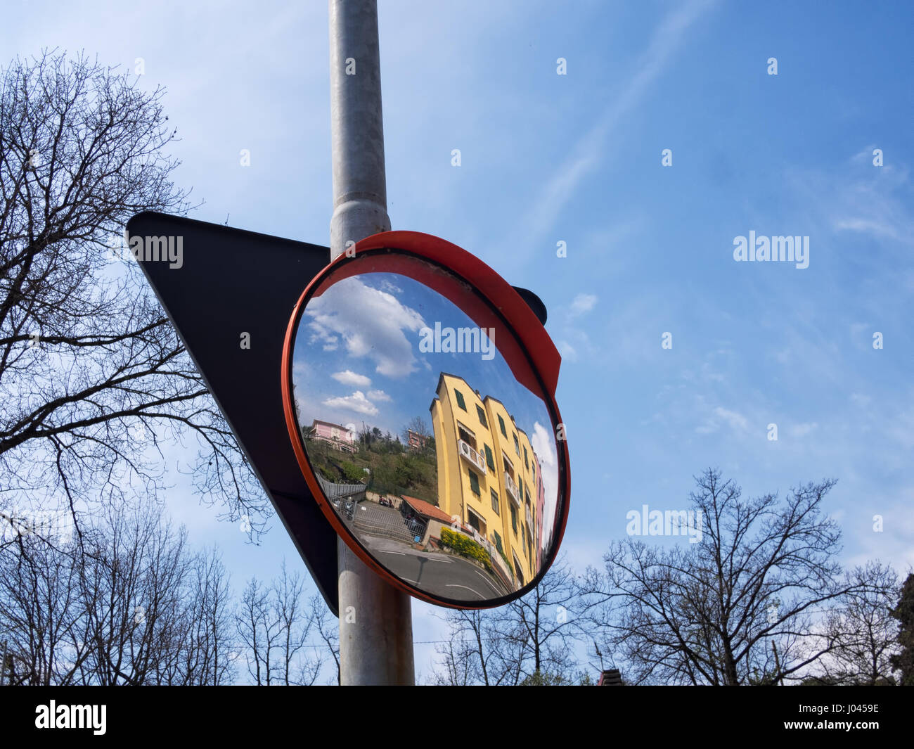 Street furniture, mirror. Fairly generic view, Italy. - Stock Image
