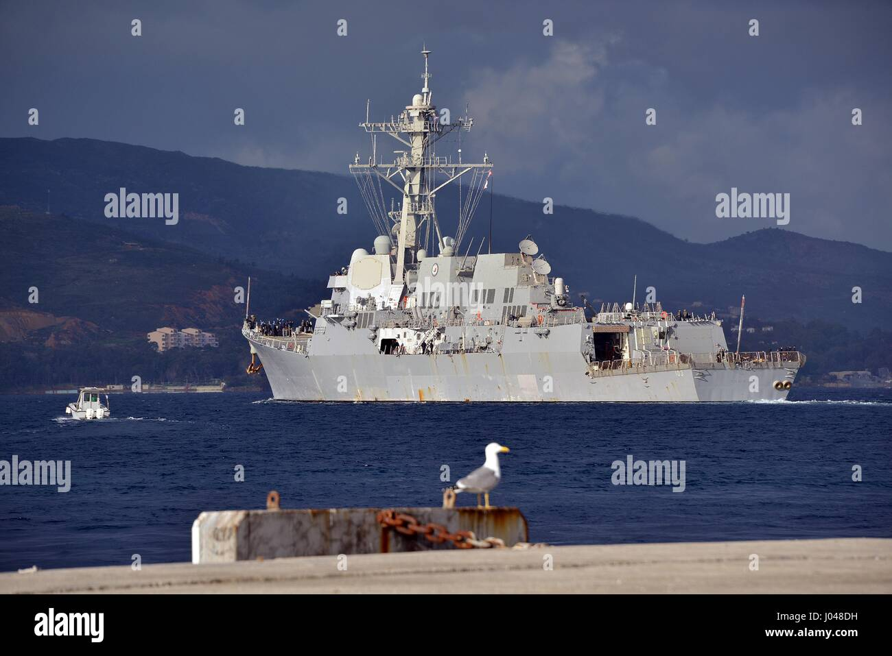 The USN Arleigh Burke-class guided-missile destroyer USS Truxtun departs the Marathi NATO pier facility March 6, - Stock Image